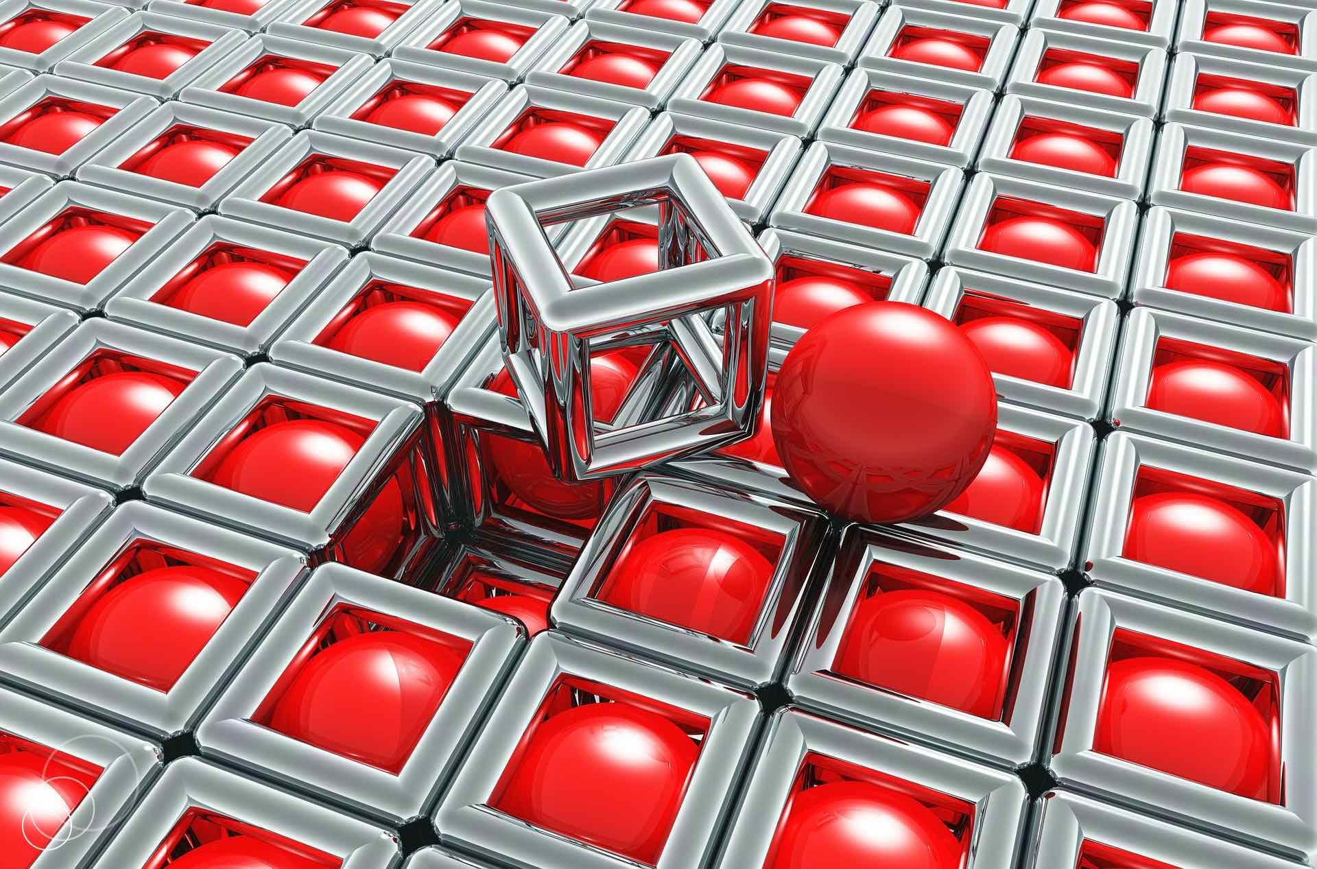 Feld mit silbernen Würfeln, deren Flächen leer sind. In den Würfeln sind rote Kugeln, die durch die freien Flächen sichtbar sind. Ein Würfel ist herausgenommen und liegt auf dem Feld, daneben die rote Kugel
